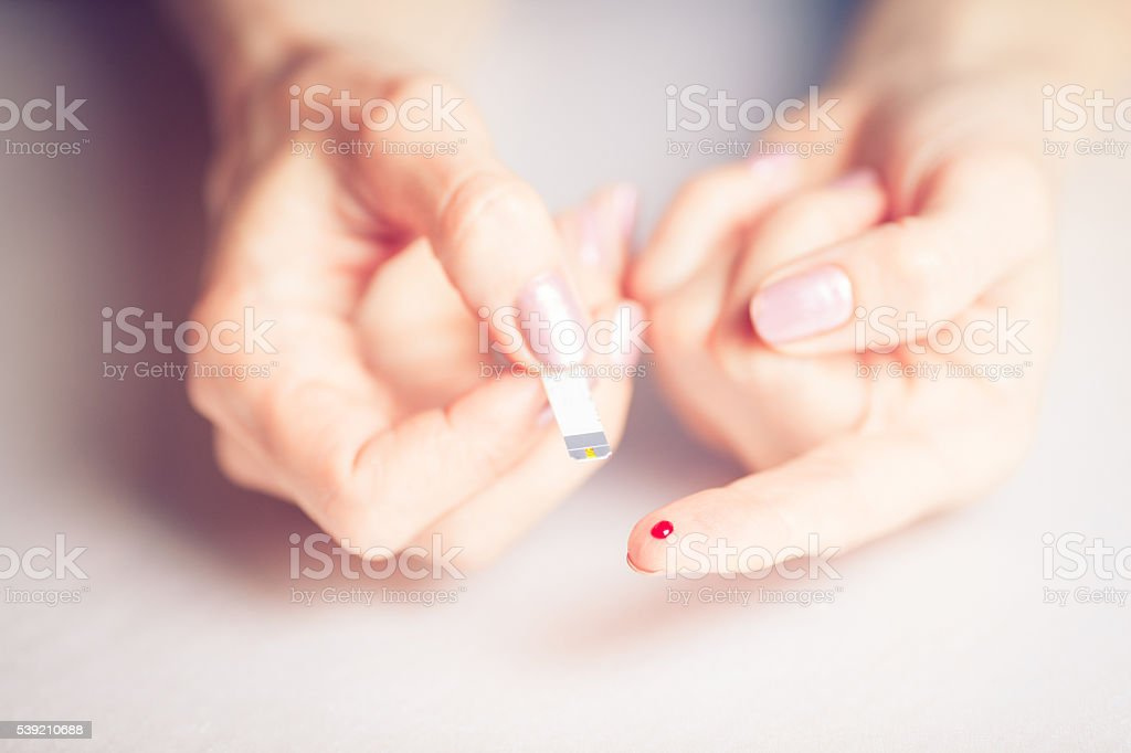 Testing High Blood Sugar With Glucometer, Blood glucose meter stock photo