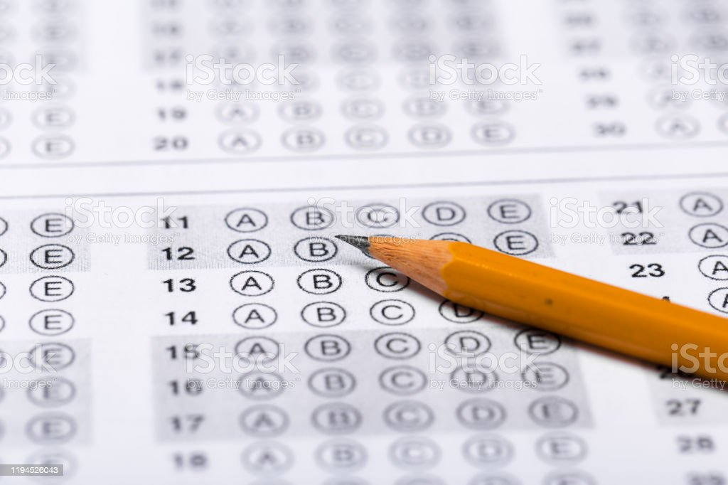pencil for the exam. printed school test\