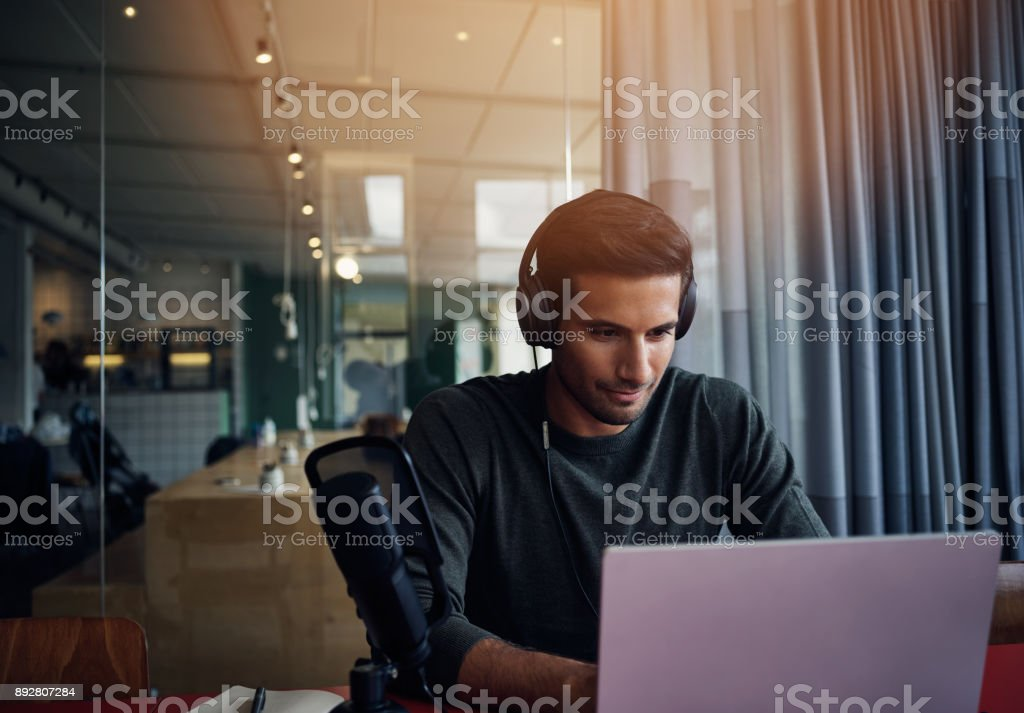 Testing out podcast equipment stock photo