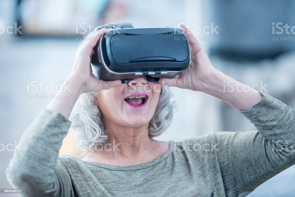 Testing Out Virtual Reality - Royalty-free 70-79 Years Stock Photo