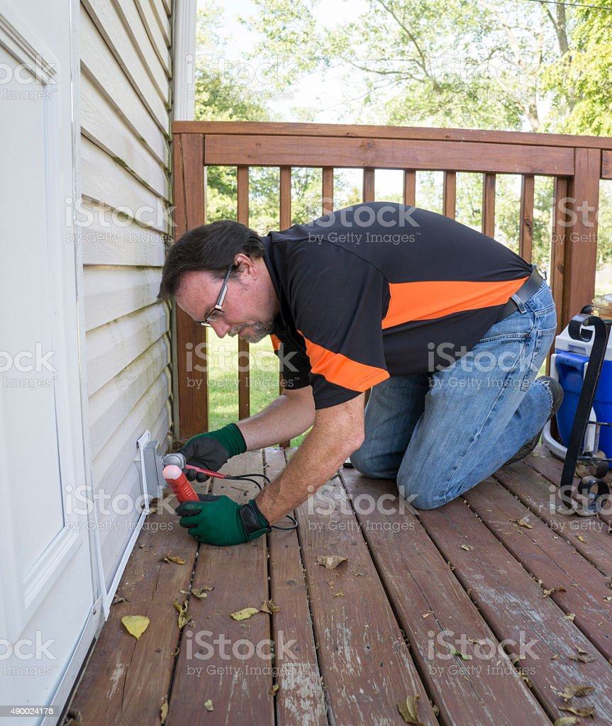 Testing Outside Outlet On Patio Deck stock photo