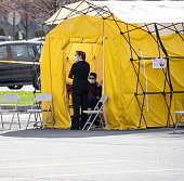 Reading, Berks County, Pennsylvania, USA - April 3, 2020, Penn State Health Network, St. Joseph Hospital, nurses wait to test patients in COVID-19 testing tent outside hospital