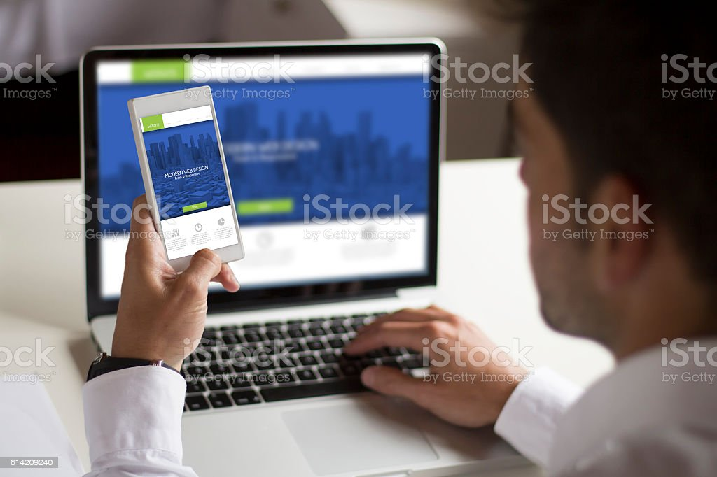 testing responsive design with smartphone stock photo
