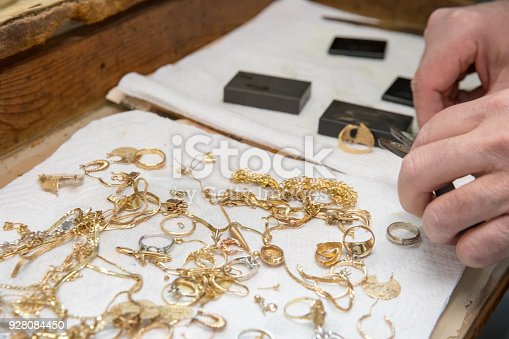 Jeweler is using equipment to test scrap gold. Shot with Canon 5D Mark lV.