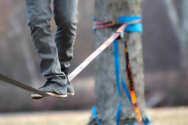testing the slackline - balance beam stock photos and pictures