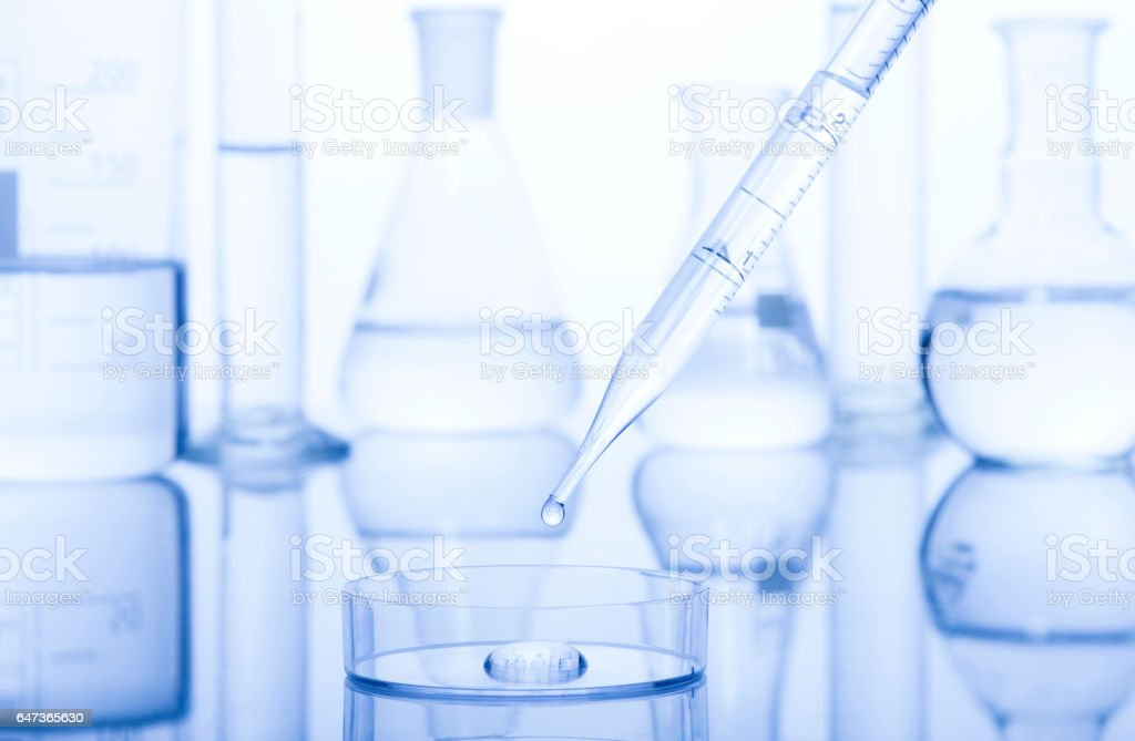 Test-tubes on a white and blue background. Test-tubes with reflections on a white and blue background. Laboratory glassware. Analyzing Stock Photo
