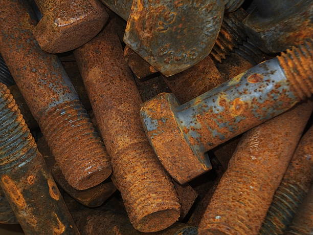 Tetanus Close-up of large rusty bolts. tetanus stock pictures, royalty-free photos & images