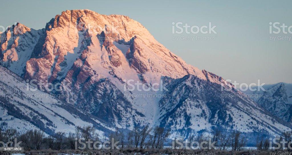 Tetons and Mount Moran in morning Alpenglow stock photo