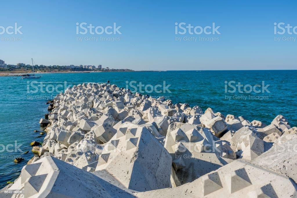 Tetra-pods or concrete breakwater blocks at Tomis, Constanta harbor. stock photo