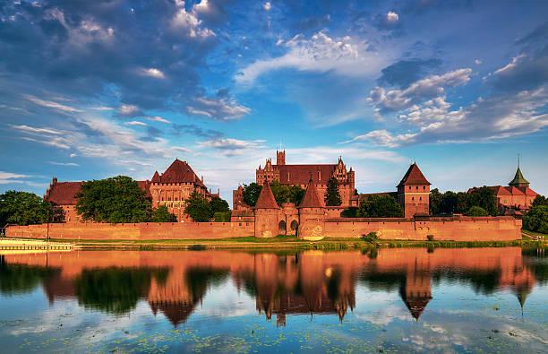 Teutonic Knights in Malbork castle in summer stock photo