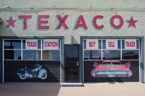 Tucumcari, United States - May 16, 2014: The Texaco Trade Station is a service station along historic Route 66 in Tucumcari, New Mexico.  It still has original Texaco gas pumps, but the price of fuel has certainly changed since the Mother Road was popular!