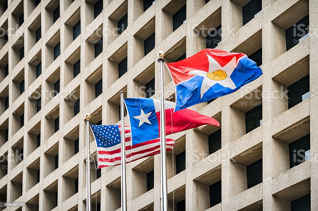 USA Texas and Dallas Flags  and Office Building in Dallas stock photo