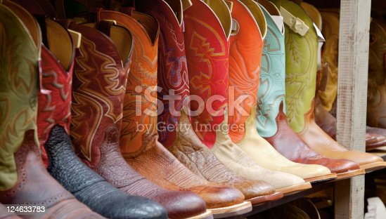 A row of boots sits for sale in a Dallas, TX western wear store. Shot with Canon EOS 5D.