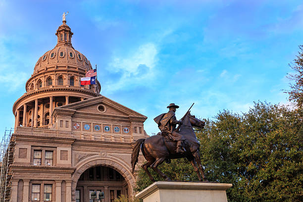 Texas Capitol and Ranger Statue The Texas Ranger statue in front of the Texas Capital building in Austin, TX state capitol building stock pictures, royalty-free photos & images