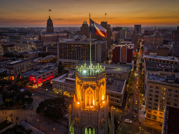 Texas Flag in San Antonio, Texas Aerial photo taken over a building with a Texas Flag in downtown San Antonio, Texas during sunset. san antonio texas stock pictures, royalty-free photos & images