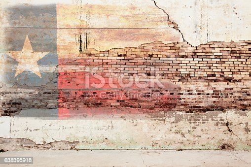 Texas flag painted on grunge brick wall.  Old peeling paint, rustic, weathered. Red, white, blue with one white star.  Great Texas background.