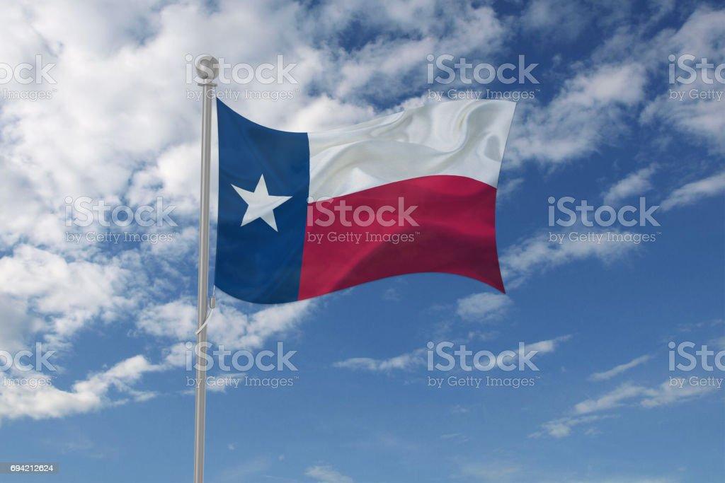 Texas flag waving in the sky stock photo