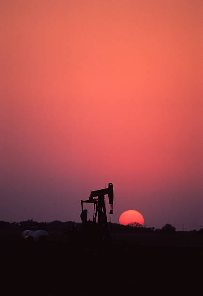 Texas oil well at sunset stock photo