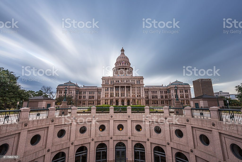 Texas state capital building with dramatic cloud moving stock photo