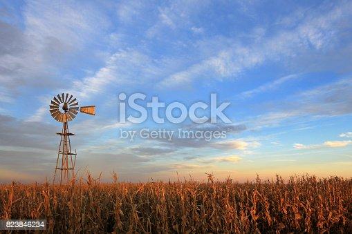 istock Texas style westernmill windmill at sunset, Argentina 823846234