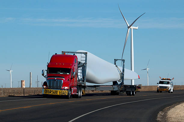 Texas wind farm and semi-truck blade transport stock photo