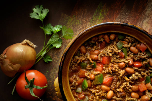 texmex food: chili con carne still life - chilli stock photos and pictures