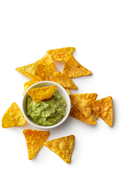 texmex food: nacho chips and guacamole isolated on white background - chipsy zdjęcia i obrazy z banku zdjęć