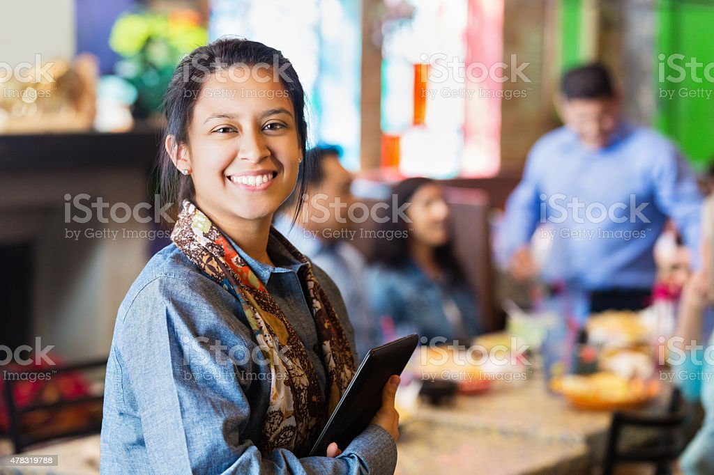 Tex-Mex restaurant manager holding digital tablet at work stock photo