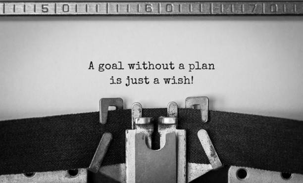 Text Ein Ziel ohne Plan ist nur ein Wunsch, der auf retro-Schreibmaschine eingegeben wird – Foto