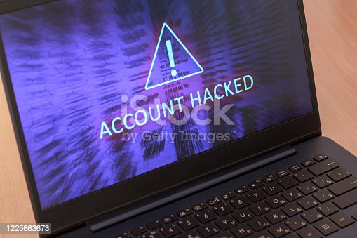 Text account hacked on laptop screen. Warning triangular sign with exclamation mark symbol. Blue screen. Horizontal.