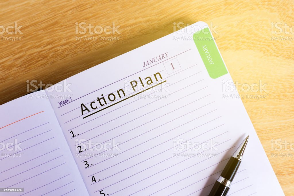Text Action plan on Notepad stock photo