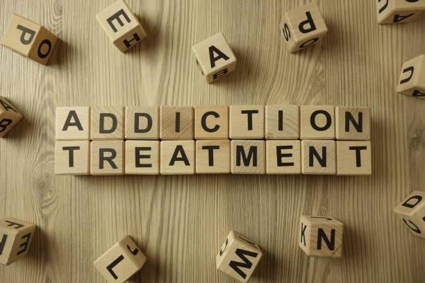 Text addiction treatment from wooden blocks stock photo