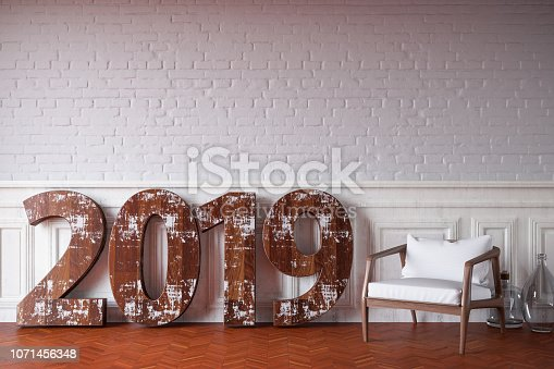 istock 2019 Text Against Brick Wall with Chair 1071456348