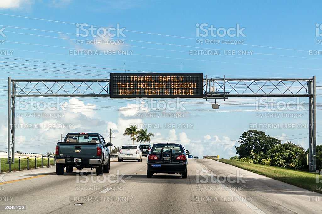 Text and drive warning on electronic message board in Florida stock photo