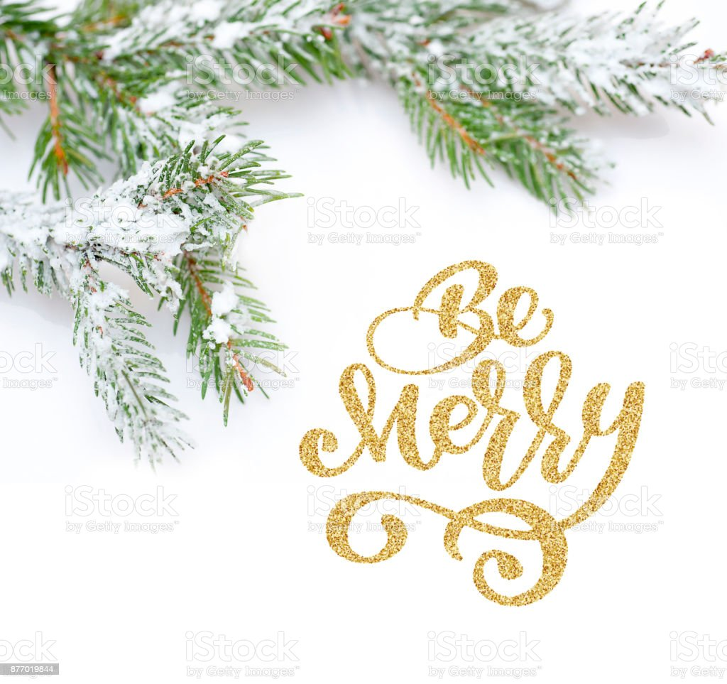 text Be Merry of Christmas tree in snow, on white background. Flat lay, top view photo mockup stock photo
