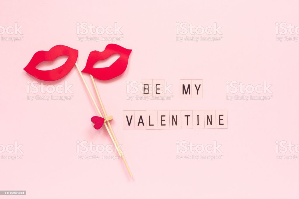 Text Be my Valentine and couple paper lips props on stick fastened clothespin heart on pink background. Concept lesbian love Creative Valentine's Day, Valentine card Top view Text Be my Valentine and couple paper lips props on stick fastened clothespin heart on pink background. Concept lesbian love Creative Valentine's Day, Valentine card Top view Flat lay Bisexuality Stock Photo