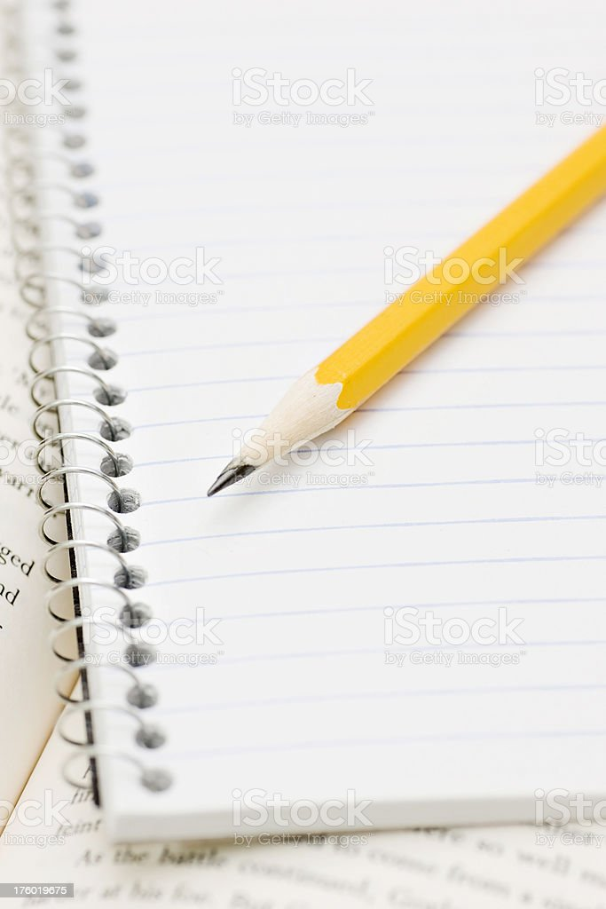 text book, spiral note pad and pencil royalty-free stock photo