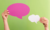 Pink and White text Bubbles isolated on green background