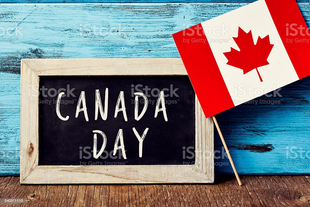 text Canada Day and flag of Canada stock photo
