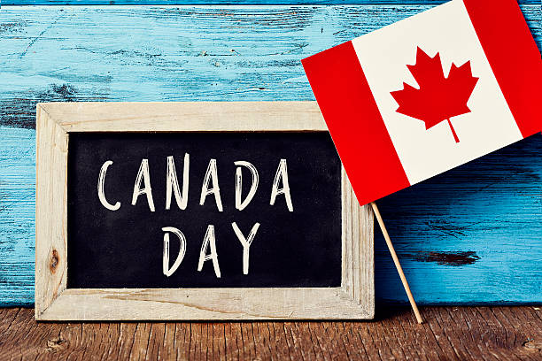 text canada day and flag of canada - canada day stock pictures, royalty-free photos & images