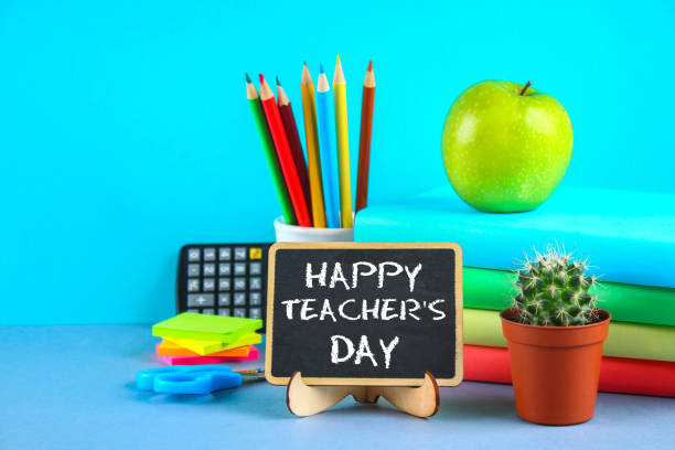 text chalk on a chalkboard: happy teacher's day. school supplies, office, books, apple. - teachers day stock photos and pictures