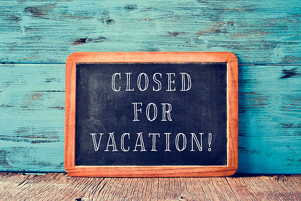 text closed for vacation in a chalkboard - closed stock photos and pictures