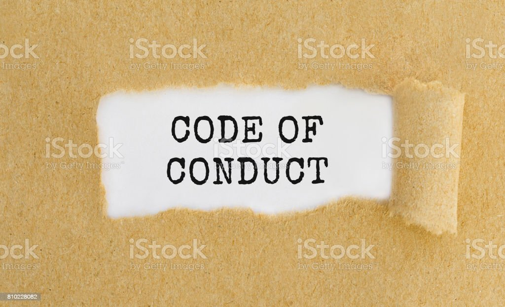 Text Code of Conduct appearing behind ripped brown paper. stock photo