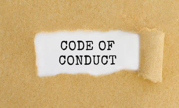 text code of conduct appearing behind ripped brown paper. - social issues stock pictures, royalty-free photos & images