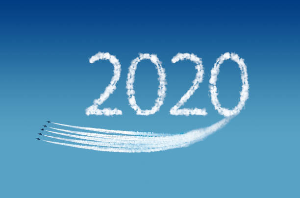 2020 text, computer graphics, represented by airplane trails. New Year Concept. stock photo