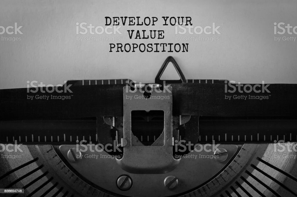 Text Develop Your Value Proposition typed on retro typewriter stock photo