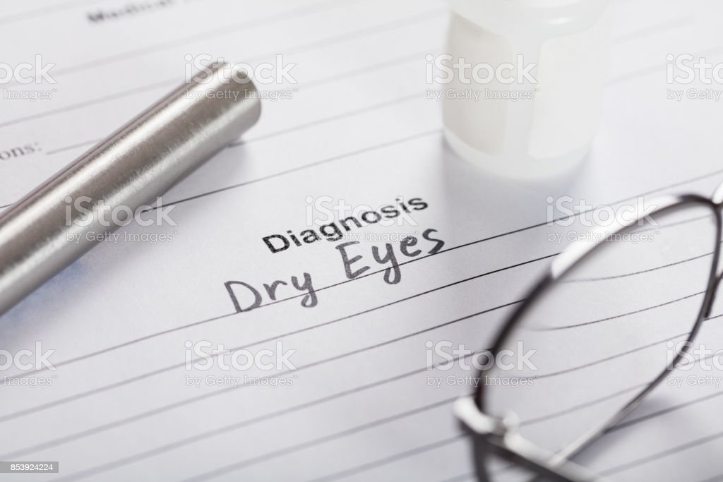 Text Diagnosis Dry Eyes On Paper With Glasses And Medicine stock photo