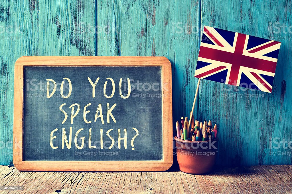 text do you speak english? in a chalkboard, filtered royalty-free stock photo
