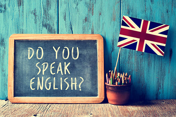 text do you speak english? in a chalkboard, filtered - engeland stockfoto's en -beelden
