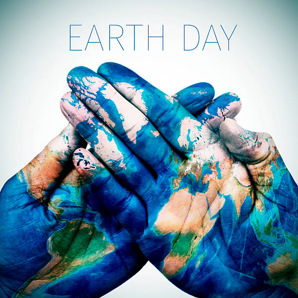text earth day and world map (furnished by nasa) - earth day stock pictures, royalty-free photos & images
